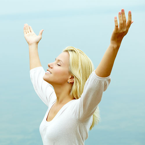 woman with hands in air feeling free